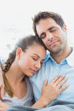 Peaceful couple relaxing on their sofa under blanket Royalty Free Stock Images