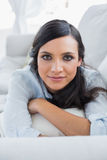 Peaceful dark hair woman lying on the couch Stock Photo