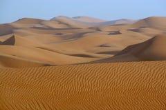 Desert dunes. Peaceful desert dunes at sunset stock images