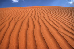 Peaceful Desert Under Blue Sky on a Sunny Climate Stock Images