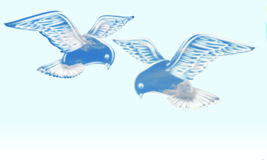 Peaceful doves. Two free fliyng doves on a sky background Royalty Free Stock Photography