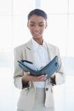 Peaceful elegant businesswoman holding her agenda Stock Photography