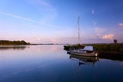Peaceful evening with on lake. Peaceful evening with boat on lake stock photos