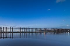 Peaceful evening U Bein Bridge, Mandalay, Myanmar. U Bein Bridge is one of most popular landmark of Mandalay Region, is situated not far from the city and royalty free stock photos