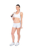 Peaceful fit sportswoman holding skipping rope around neck Royalty Free Stock Photography