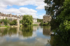 Peaceful  French village. Beautiful postcard of a peaceful  French village with a river Stock Images