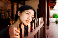 Peaceful gaze. Studious Asian girl looks peacefully off into the distance Stock Photography