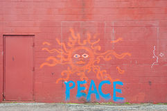 Peaceful graffiti on a red wall Stock Photos