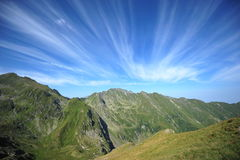 Peaceful green mountains under a blue summer sky Royalty Free Stock Photo