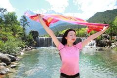 Peaceful happy life, Asian Chinese embrace nature. Asian Chinese woman yoga by a lake, Yulong snow capped mountains on the background, beautiful landscape Royalty Free Stock Images