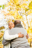 Peaceful happy senior couple embracing. In parkland Royalty Free Stock Photography