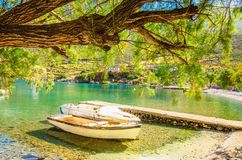 Peaceful haven with boat in sea bay, Greece Royalty Free Stock Photo