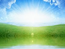 Light from heaven, bright sunlight with reflection in water, gre. Peaceful heavenly background - light from heaven, bright sunlight with reflection in water Royalty Free Stock Photography