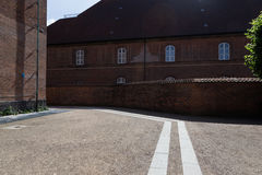 Peaceful isolated road with historical brick building in Copenhagen. Historical brick building in Copenhagen stock images
