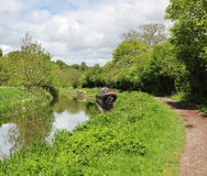 Peaceful Kennett & Avon Canal in Wiltshie. Narrowboat on the Kennet & Avon Canal in Wiltshire Royalty Free Stock Photography