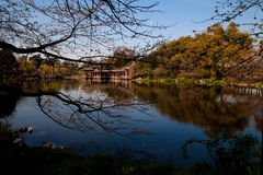 Peaceful Lake. A Chinese Pavilion stands on a peaceful lake that is located in the Hangzhou city, Zhejiang Province. It's near the famous Xihu Lake Royalty Free Stock Photos