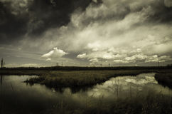Peaceful lake with dark clouds Stock Photography