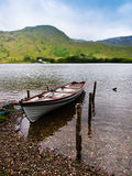 Peaceful lake in Ireland. A small boat in a lake, Ireland. Peaceful atmosphere Royalty Free Stock Image