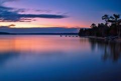 Peaceful Lake Superior Sunrise. Sunrise reflections along the shores of a calm Lake Superior Stock Images