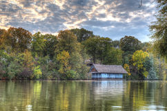 Peaceful lake view with old cabin Stock Images