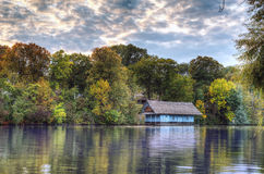 Peaceful lake view with old cabin on Herastrau lake Royalty Free Stock Photography