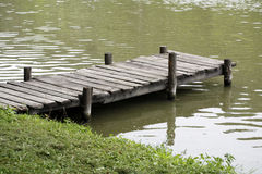 Peaceful lake with weathered rustic vintage jetty Royalty Free Stock Images