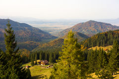 Hut in the mountain area. Peaceful landscape of a beautiful chalet in the Carpathian Mountains area during autumn season Royalty Free Stock Image