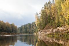 Peaceful landscape with Gauja river and white sandstone outcrops. Peaceful autumn landscape with Gauja river and white sandstone Sietiniezis outcrops Royalty Free Stock Photos