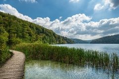 Peaceful landscape with path around lake Stock Image