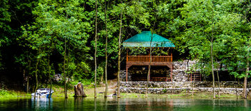 Peaceful Life. A small wooden balcony for relaxation in Skopje Matka Lake Royalty Free Stock Photography