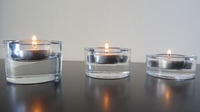 Candles by size. Peaceful light of three candles Royalty Free Stock Images