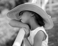 Peaceful little girl in a big hat Royalty Free Stock Image