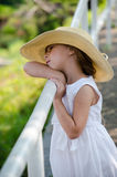 Peaceful little girl in a straw hat Royalty Free Stock Image