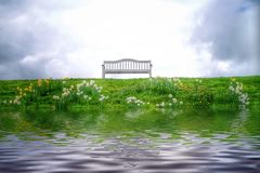 Peaceful lonely bench by the lake. Stock Image