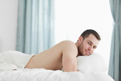 Peaceful man lying on his belly Royalty Free Stock Images