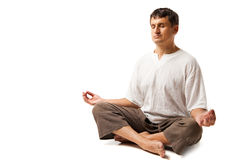 Peaceful man meditating isolated over white Stock Image