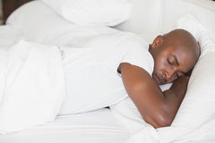 Peaceful man sleeping in bed Royalty Free Stock Image