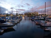 Peaceful Marina. Reflective lights in a peaceful quiet marina Royalty Free Stock Photography