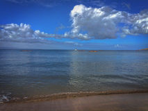 Peaceful Maui waves. Beautiful blue sky and calm Maui waves Royalty Free Stock Images