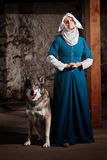 Nun with Dog Indoors Stock Photo
