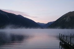 Peaceful misty morning on lake bank Royalty Free Stock Image