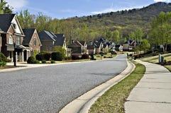Peaceful Modern Neighborhood. Sidewalk and street in a beautiful modern neighborhood Royalty Free Stock Photos