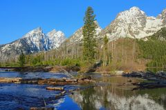 Grand Teton Range reflected in the Rapids at the End of String Lake, Grand Teton National Park, Wyoming stock photos