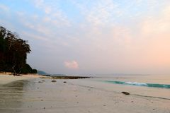 Peaceful Morning at Pristine Beach with Pink Sky - Natural Background - Kalapathar Beach, Havelock Island, Andaman, India. This is a photograph of a peaceful royalty free stock image