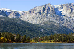 Peaceful Mountain Lake. With fishing boat in California's Sierra Nevada Stock Photography