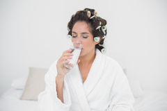 Peaceful natural brunette drinking glass of water Royalty Free Stock Photography