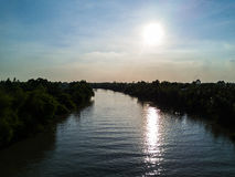 The peaceful nature of sky, sun, and river. The river is quiet peaceful in the sunny day, in Vietnam. Taking with drone Stock Photos