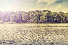 Peaceful nature vintage lake background. Royalty Free Stock Photo