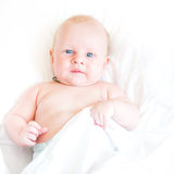 Peaceful newborn baby lying on a bed Royalty Free Stock Photos