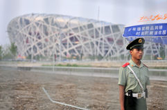 Peaceful olympics?. A solder watching Beijing National Stadium, (also known as the National Stadium  or the Bird's Nest  for its architecture, is a stadium Stock Photos